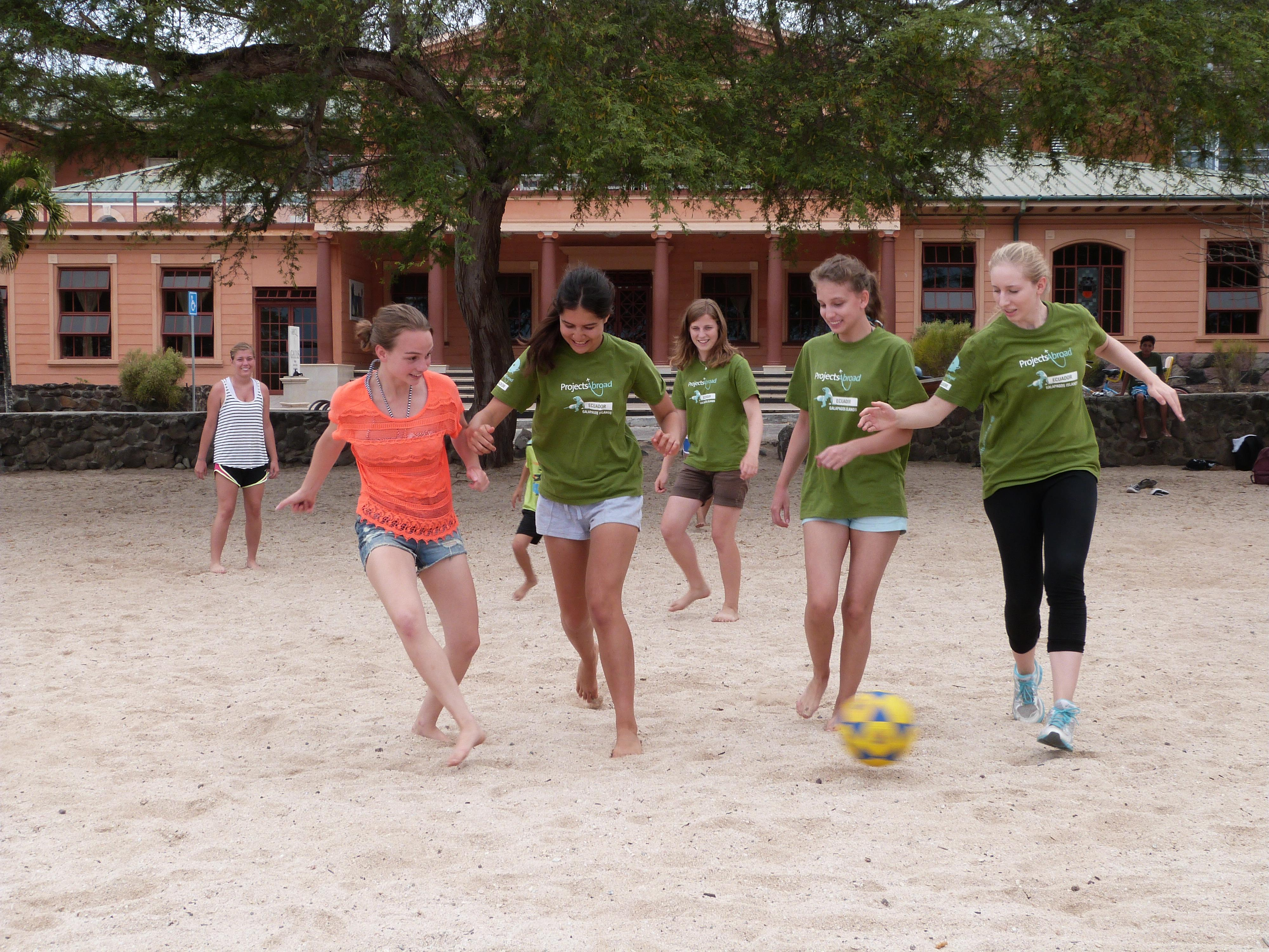Volunteers play football and work in the Galapagos during Projects Abroad's programme for high school students
